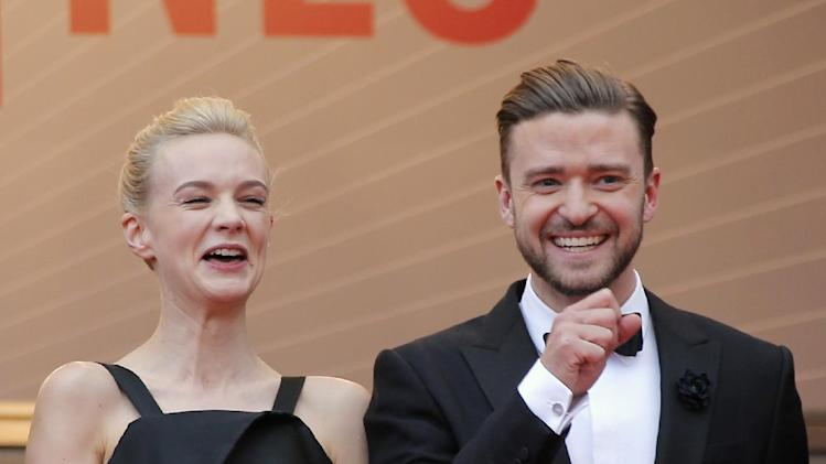 Actors Carey Mulligan, left, and Justin Timberlake laugh as they arrive for the screening of the film Inside Llewyn Davis at the 66th international film festival, in Cannes, southern France, Sunday, May 19, 2013. (AP Photo/Lionel Cironneau)