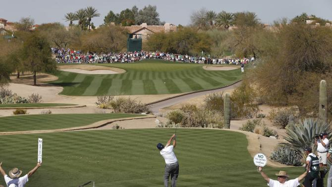 Phil Mickelson hits from the seventh tee during the third round of the Waste Management Phoenix Open golf tournament, Saturday, Feb. 2, 2013, in Scottsdale, Ariz. (AP Photo/Matt York)