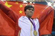 China's Sun Yang poses on the podium with the gold medal after winning the men's 1500m freestyle final during the swimming event at the London 2012 Olympic Games