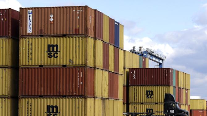 In this March 1, 2013 photo, a truck drives past stacks of containers that were unloaded from a ship at the Port of Baltimore's Seagirt Marine Terminal in Baltimore. Orders to U.S. factories fell in March by the largest amount in seven months but a key category that signals business investment plans managed a small increase, according to the Commerce Department, Friday, May 3, 2013. (AP Photo/Patrick Semansky)