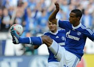 Schalke's Cameroonian defender Joel Matip plays the ball during the German first division Bundesliga football match FC Schalke 04 vs FC Bayern Munich on September 22, in Gelsenkirchen, western Germany. Bayern Munich won the match 2-0