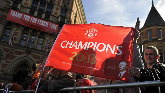 Manchester United fans celebrate during the premiership trophy parade at Albert Square in Manchester, England, Monday May 13, 2013. (AP Photo/Clint Hughes)