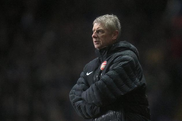 Arsene Wenger would not swap places with Manchester City, given their Champions League exit