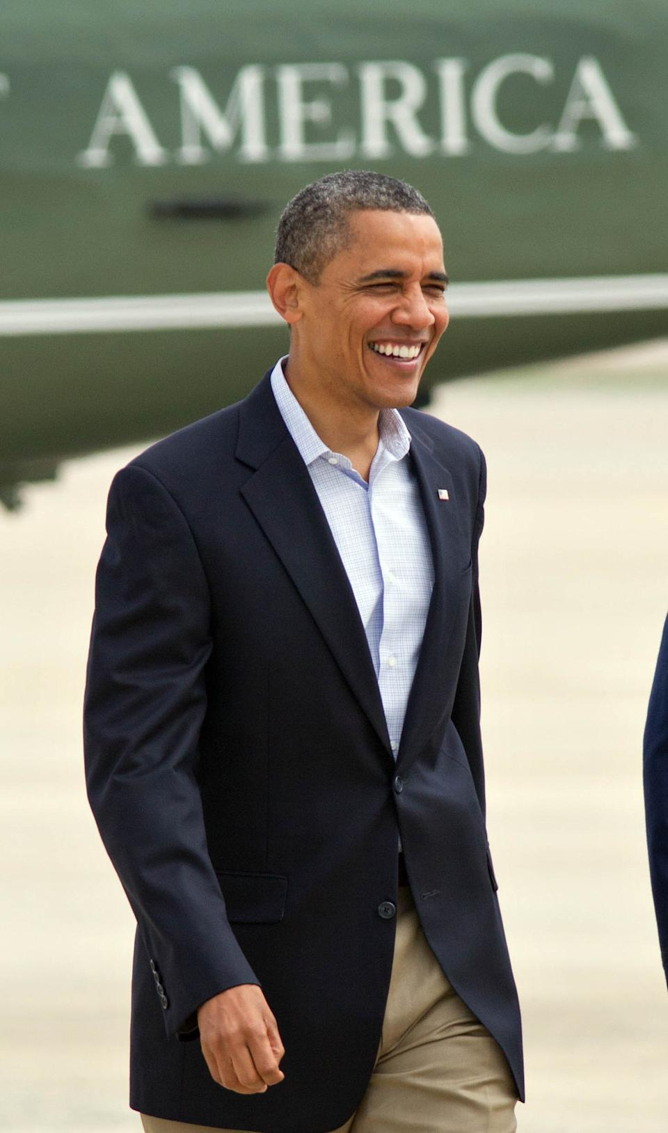 President Barack Obama heads to Air Force One for a second day of campaigning in Virginia, a crucial swing state he won four years ago, Saturday, July 14, 2012, at Andrews Air Force Base, Md. (AP Photo/J. Scott Applewhite)