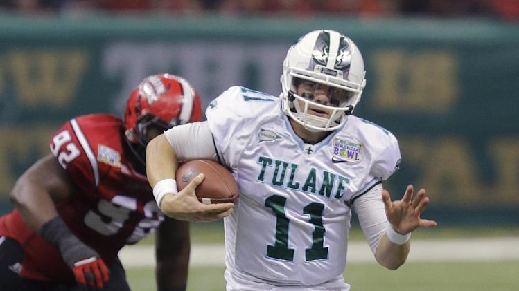 Tulane quarterback Nick Montana (11) scrambles away from Louisiana-Lafayette defensive lineman Christian Ringo (92) during the first half of the New Orleans Bowl NCAA college football game, Saturday, Dec. 21, 2013, in New Orleans. (AP Photo/Bill Haber)