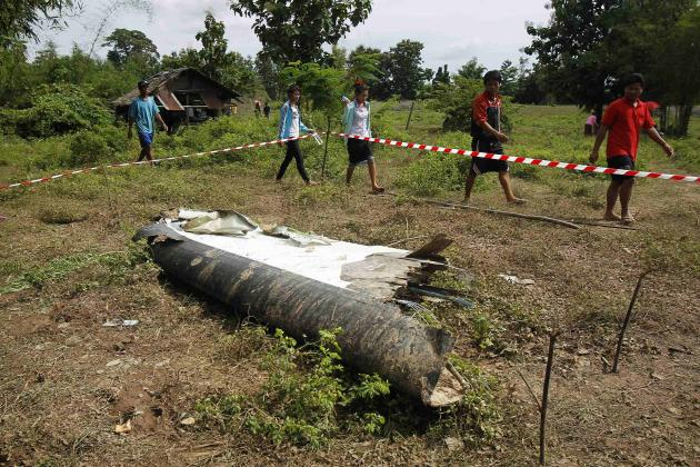 People arrive at crash site of an ATR-72 turboprop plane, in Laos, near Pakse