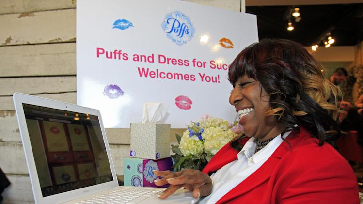 "IMAGE DISTRIBUTED FOR PUFFS - Charla Jackson sends virtual ""kisses"" during the Puffs Tissues 'Kisses"" event on Tuesday, Feb. 12, 2013 at High Five Salon in Cincinnati, Ohio, home of Proctor & Gamble. (Skip Peterson/AP Images for Puffs)"