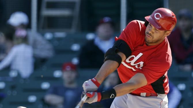 Cincinnati Reds' Donald Lutz drives in two runs with a bases-loaded double against the Arizona Diamondbacks during the sixth inning of an exhibition spring training baseball game, Wednesday, Feb. 27, 2013, in Scottsdale, Ariz. (AP Photo/Marcio Jose Sanchez)