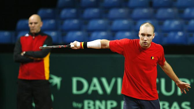 Belgium's Steve Darcis and Team Captain Johan Van Herck during practice