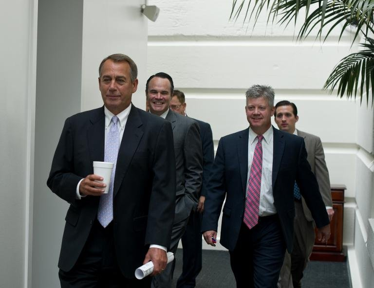 US House Speaker John Boehner (L) arrives at a meeting of Republican members of the House of Representatives at the US Capitol on September 28, 2013 in Washington