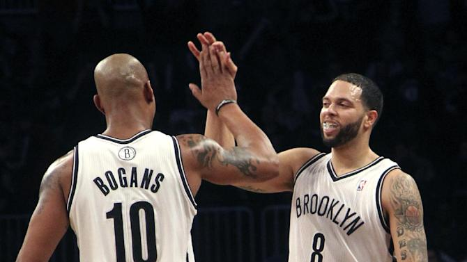 Brooklyn Nets' Deron Williams (8) celebrates with Keith Bogans after scoring a basket during the first half of NBA basketball game, Friday, March 8, 2013, in New York. Williams set the NBA record with nine 3-pointers in a half during the first half of their game. (AP Photo/Mary Altaffer)