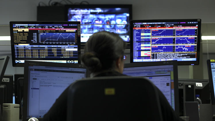 A broker works in a trading room of a Portuguese bank in Lisbon, Tuesday, May 7, 2013. Portugal held a sale of its 10-year bonds on Tuesday for the first time since it needed a bailout in 2011, representing a milestone in its efforts to regain investor confidence and prove its contested austerity policies are paying off. (AP Photo/Francisco Seco)