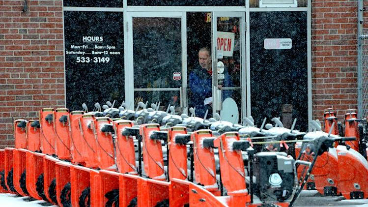 "A customer leaves Taft Power Equipment in Holyoke, Mass.  as new snow blowers line the entrance on Friday, Feb. 8, 2013.   Massachusetts Gov. Deval Patrick declared a state of emergency Friday and banned travel on roads as of 4 p.m. as a blizzard that could bring nearly 3 feet of snow to the region began to intensify. As the storm gains strength, it will bring ""extremely dangerous conditions"" with bands of snow dropping up to 2 to 3 inches per hour at the height of the blizzard, Patrick said.   (AP Photo/The Republican, Dave Roback)"
