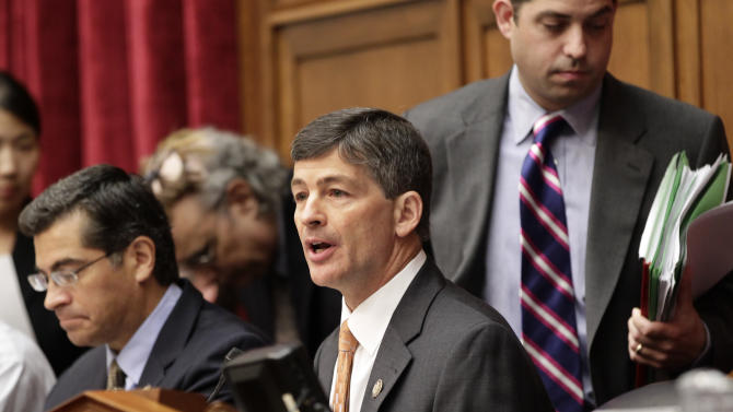 """Rep. Jeb Hensarling, R-Texas, center, joined by Rep. Xavier Becerra, D-Calif., left, opens the first meeting of the Joint Select Committee on Deficit Reduction, often called the """"supercommittee"""", on Capitol Hill in Washington, Thursday, Sept. 8, 2011.  Made up of six Republican and six Democratic members of Congress, the panel is charged with finding, by Thanksgiving, $1.5 trillion in savings over the next decade.  (AP Photo/J. Scott Applewhite)"""