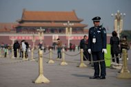 A policeman stands on Tiananmen Square in Beijng on Ocober 29, 2012. Top members of China&#39;s ruling Communist Party began their final formal meeting in Beijing on Thursday ahead of a 10-yearly power transition next week, state press reported