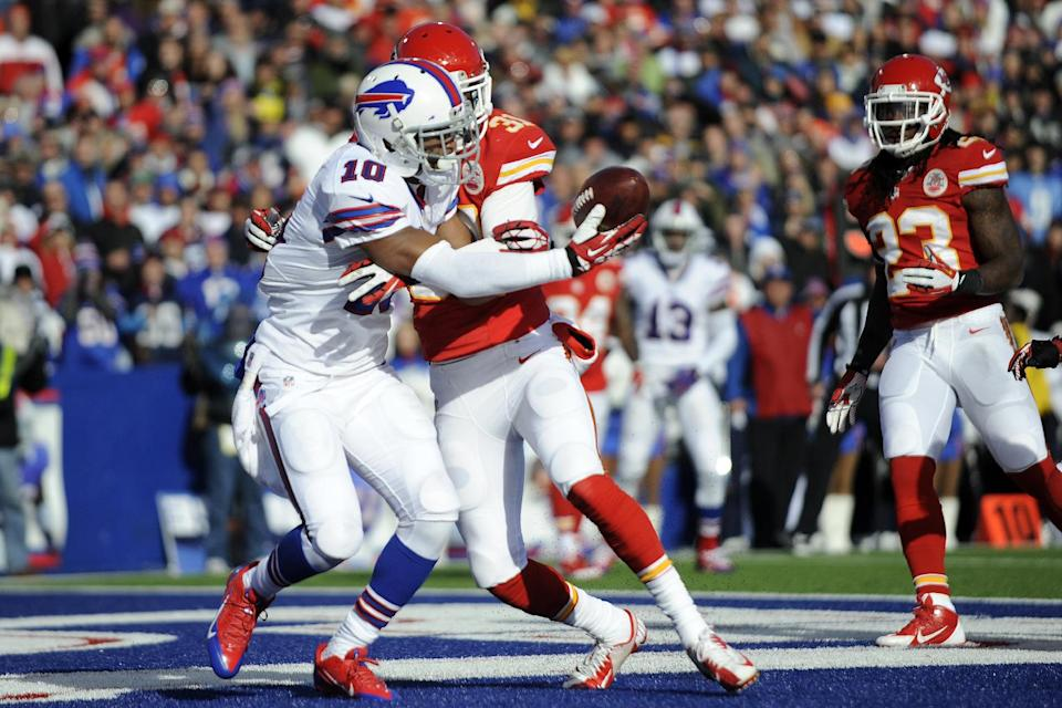 Buffalo Bills wide receiver Robert Woods (10) is hit by Kansas City Chiefs cornerback Marcus Cooper (31) and can't hang onto a pass in the endzone during the second quarter of an NFL football game in Orchard Park, N.Y., Sunday, Nov. 3, 2013. (AP Photo/Gary Wiepert)