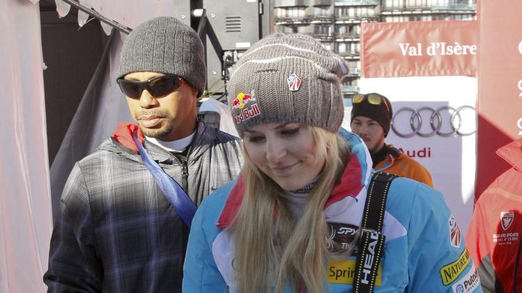 Vonn of the U.S. and her boyfriend, golfer Woods leave after the Women's World Cup Downhill skiing race in Val d'Isere