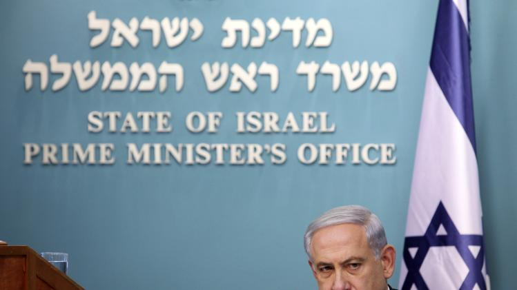 Israel's Prime Minister Benjamin Netanyahu reacts during a news conference at his office in Jerusalem