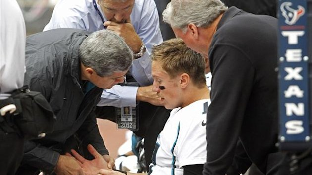 Jacksonville Jaguars quarterback Blaine Gabbert examines his arm after being sacked by Houston Texans safety Danieal Manning in Houston (Reuters)