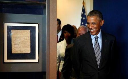 """Obama arrives to look at a copy of the original manuscript of Francis Scott Key's """"The Star Spangled Banner"""" at Fort McHenry in Baltimore"""