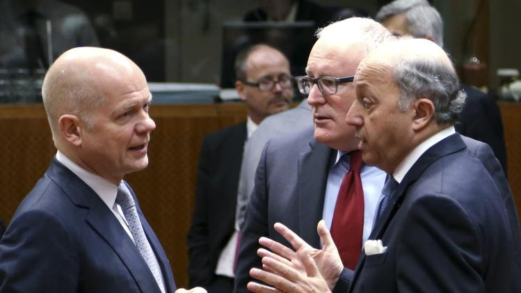 Britain's Foreign Secretary Hague, Dutch FM Timmermans and his French counterpart Fabius attend a EU foreign ministers meeting in Brussels