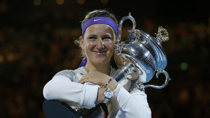Victoria Azarenka of Belarus hugs her trophy after winning the women's final against China's Li Na at the Australian Open tennis championship in Melbourne, Australia, Saturday, Jan. 26, 2013. (AP Photo/Andy Wong)