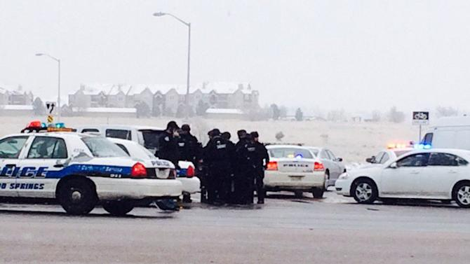 Authorities respond after reports of a shooting near a Planned Parenthood clinic Friday, Nov. 27, 2015, in Colorado Springs, Colo. Multiple officers were injured but it was not known if anyone else was wounded in the attack, authorities said. (Kody Fisher/FOX21 News via AP) MANDATORY CREDIT; COLORADO SPRINGS OUT
