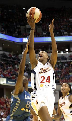 Indiana Fever forward Tamika Catchings (24) fights for a rebound with Minnesota Lynx forward Taj McWilliams-Franklin (8) in the first half of Game 3 of the WNBA basketball Finals, Friday, Oct. 19, 2012, in Indianapolis. (AP Photo/AJ Mast)