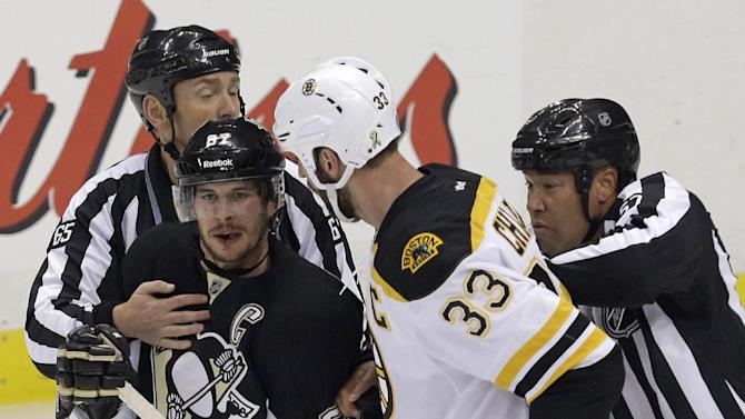Linesmen separate Pittsburgh Penguins' Sidney Crosby (87) and Boston Bruins' Zdeno Chara (33) during the first period of Game 1 in an NHL hockey Stanley Cup Eastern Conference finals in Pittsburgh, Saturday, June 1, 2013. (AP Photo/Gene J. Puskar)