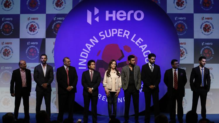 Club owners and other league officials pose for a picture during the emblem-unveiling ceremony of Indian Super League in Mumbai
