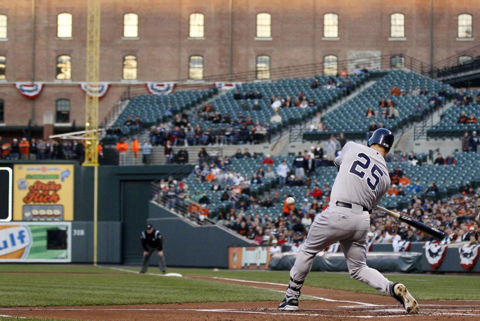 New York Yankees' Mark Teixeira  singles in the first inning of a baseball game against the Baltimore Orioles in Baltimore, Monday, April 9, 2012. Derek Jeter scored on the play. (AP Photo/Patrick Semansky)