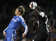 Chelsea's Fernando Torres (L) and Newcastle United's Cheick Tiote during their Premier League match on May 2. Newcastle took advantage of Chelsea's tired performance to boost their own challenge for a Champions League place