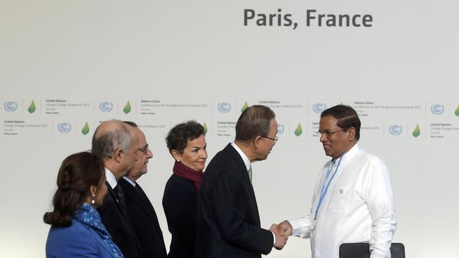 United Nations Secretary General Ban Ki-moon and French President Hollande welcome Sri Lanka's President Sirisena as he arrives for the opening day of the World Climate Change Conference 2015 (COP21) at Le Bourge