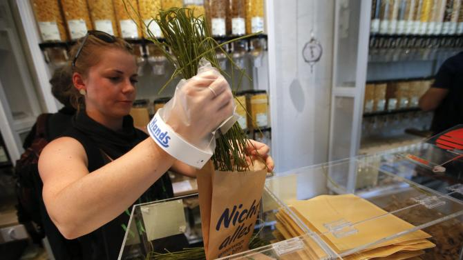 A customer selects pasta at the Original Unverpackt (Original Unpacked) zero-waste grocery store in Berlin