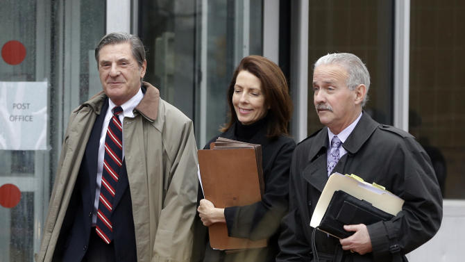 Former Michigan Supreme Court Justice Diane Hathaway leaves federal court in Ann Arbor, Mich., Tuesday, Jan. 29, 2013, with her husband, Michael Kingsley, left, and attorney Steve Fishman after pleading guilty to bank fraud. Hathaway was charged three days before quitting the court because of the scandal. Hathaway pleaded guilty to bank fraud for concealing assets, including a debt-free Florida home, while urging a bank to let her unload a Michigan house in a short sale, claiming financial hardship. (AP Photo/Carlos Osorio)