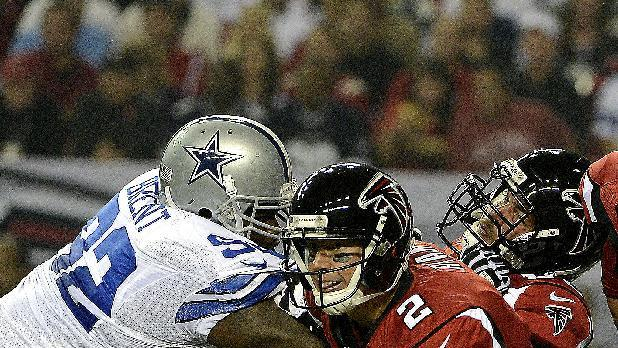 Atlanta Falcons quarterback Matt Ryan (2) rolls out as guard Peter Konz blocks Dallas Cowboys nose tackle Josh Brent (92) during the first half of an NFL football game, Sunday, Nov. 4, 2012, in Atlanta. (AP Photo/Rich Addicks)
