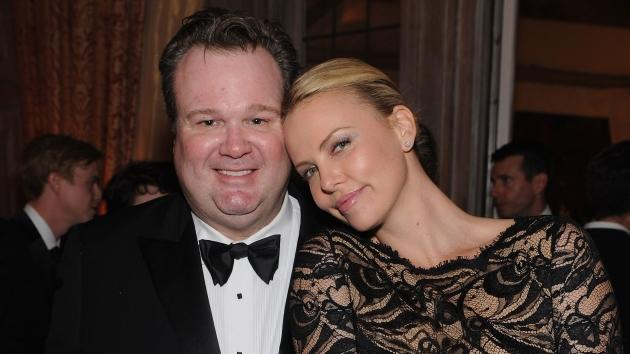 Eric Stonestreet and Charlize Theron attend the Bloomberg & Vanity Fair cocktail reception following the 2012 White House Correspondents' Association Dinner at the residence of the French Ambassador in Washington, DC on April 28, 2012  -- Getty Premium