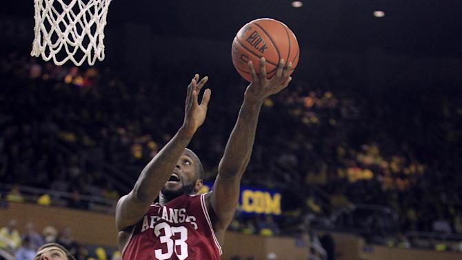 Arkansas forward Marshawn Powell (33) shoots over Michigan forward Mitch McGary (4) during the first half of an NCAA college basketball game in Ann Arbor, Mich., Saturday, Dec. 8, 2012. (AP Photo/Carlos Osorio)
