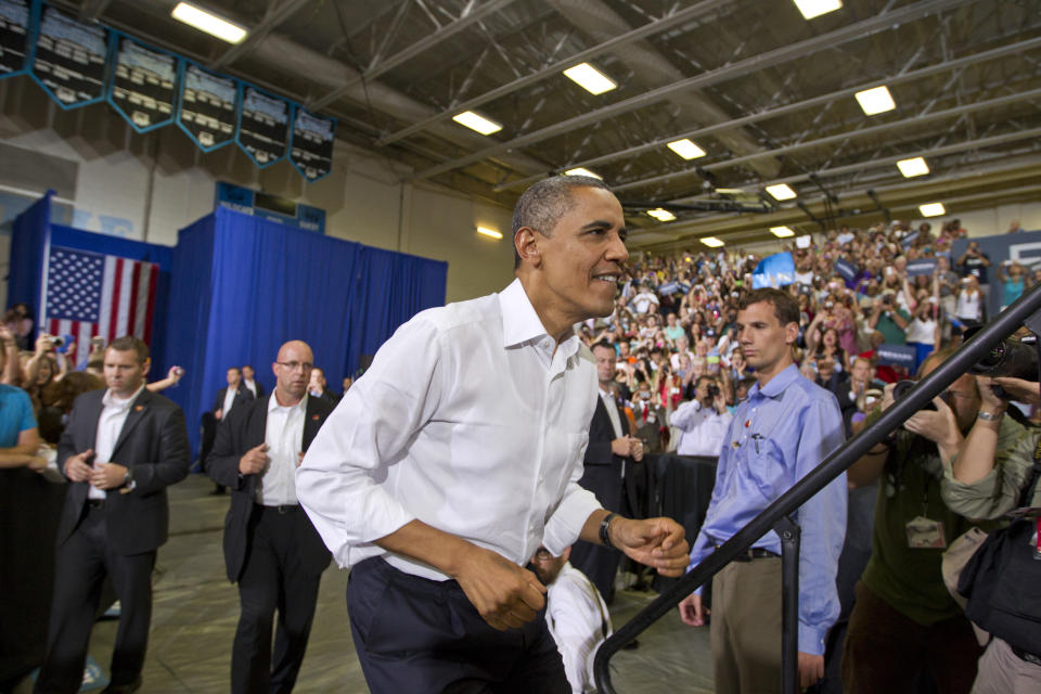 President Barack Obama walks up a set of stairs during a campaign rally at Centreville High School in Clifton, Va., a Washington suburb, on Saturday, July 14, 2012. (AP Photo/J. Scott Applewhite)
