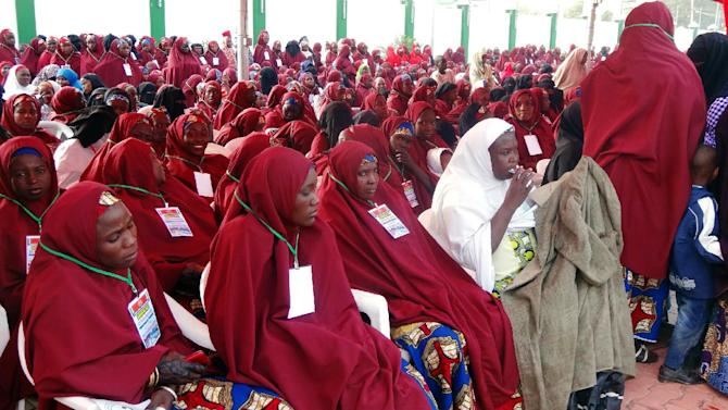 Brides attend a wedding feast at the Kano state governor's office