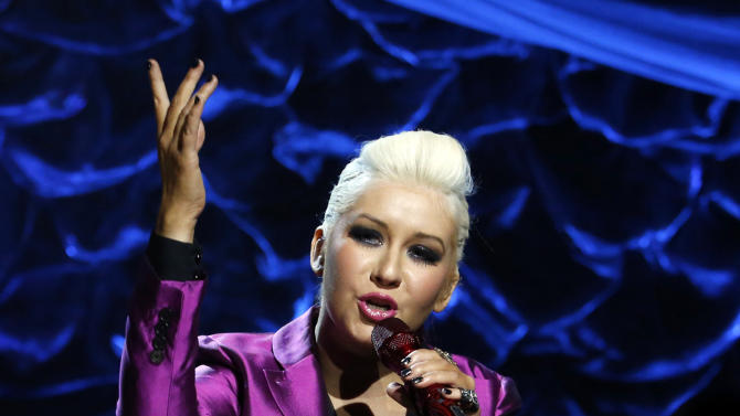 """In this photo provided by NBC, Christina Aguilera, a Staten Island native, performs during """"Hurricane Sandy: Coming Together"""" Friday, Nov. 2, 2012, in New York. Hosted by Matt Lauer, the event is heavy on stars identified with New Jersey and the New York metropolitan area, which took the brunt of this week's deadly storm. (AP Photo/NBC, Heidi Gutman)"""