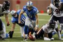 Detroit Lions quarterback Matthew Stafford chases the ball after a fumble and before Chicago Bears defensive end Julius Peppers recovers the ball during the first half of their NFL football game in Detroit,