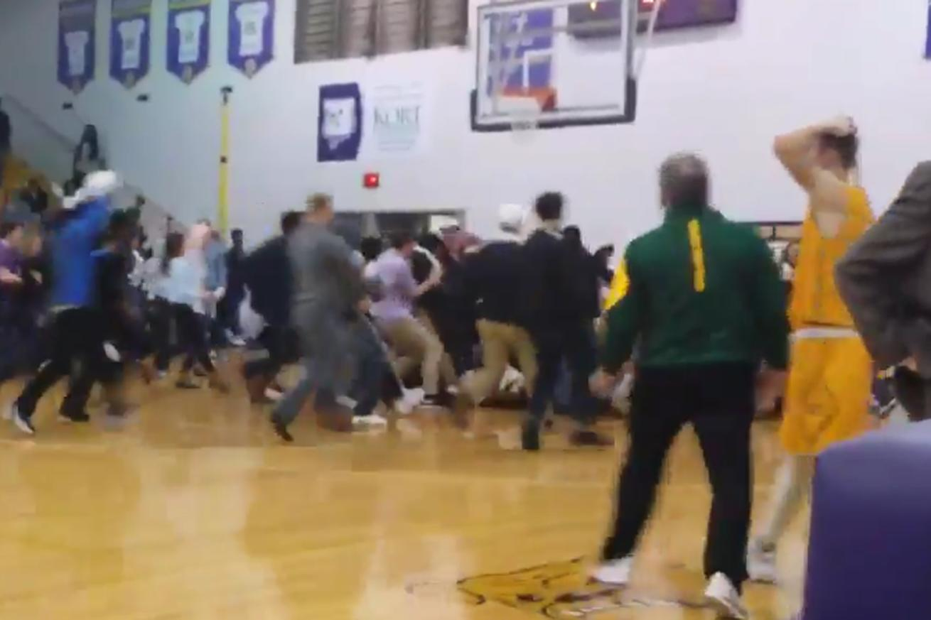Crowd storms the court after high school basketball player hits unbelievable game-winning shot