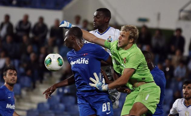 Porto's Martinez fights for the ball with Belenenses' goalkeeper Jones and Diakite during their Portuguese Premier League soccer match in Lisbon