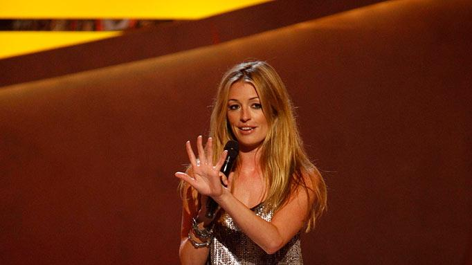 "Cat Deeley paired a dress from Zara with a vintage Chloe belt, simple black Louboutins and bracelets by Mulberry and Lanvin when the Season 5 ""So You Think You Can Dance"" contestant pool was narrowed from 14 to 12."