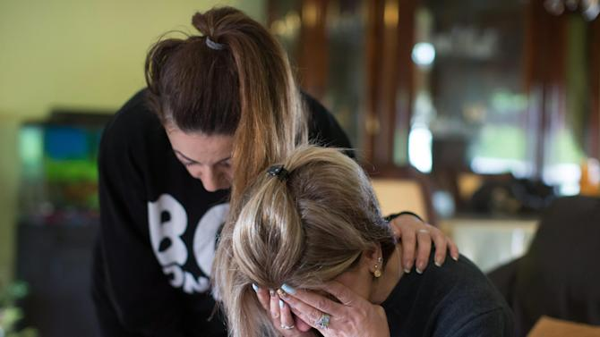 Tima Kurdi is comforted by friend Hoba Said as she is overcome with emotion as she looks at photos of her late nephews Alan and Galib Kurdi, at her home in Coquitlam, B.C., Canada, on Thursday, Sept. 3, 2015. The body of 3-year-old Syrian Alan Kurdi was found on a Turkish beach after the small rubber boat he, his 5-year old brother Galib and their mother, Rehan, were in capsized during a desperate voyage from Turkey to Greece. The family stated that the spelling of the boys' names had been changed by Turkish authorities to Aylan and Galip, but were in fact spelled as Alan and Galib.  (Darryl Dyck/The Canadian Press via AP) MANDATORY CREDIT