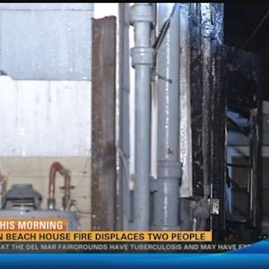 Ocean Beach house fire displaces two people