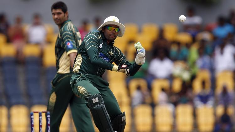 Pakistan's wicketkeeper Akmal throws the ball during their first ODI cricket match against Sri Lanka in Hambantota