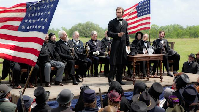 """This film image released by 20th Century Fox shows Benjamin Walker portraying Abraham Lincoln in a scene from """"Abraham Lincoln: Vampire Hunter."""" (AP Photo/20th Century Fox, Stephen Vaughan)"""