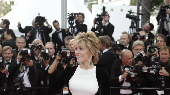 """FILE - This May 17, 2012 file photo shows actress Jane Fonda arrives for the screening of Rust and Bone at the 65th international film festival, in Cannes, southern France. Stella McCartney dress _ or dresses. McCartney, no stranger to the red carpet, has created a style that celebrities can't get enough of. Her ultra-flattering """"silhouette"""" dress has become almost ubiquitous. It features one color on the bodice and back, and a graphic opposite on the sides and sleeves. Kate Winslet has worn several versions, and Brooklyn Decker, Kate Moss, Edie Falco and Liv Tyler have, too. The best turn might have been Jane Fonda at the Cannes Film Festival. (AP Photo/Lionel Cironneau, file)"""